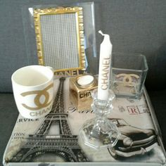 1 frame 8?8 with logo Chanel Vinty  1 mug with logo Chanel Vinty  1 vase with logo Chanel Vinty size 3in  1 holder candle glass with long candle Chanel  1 holder candle with logo Chanel Vinty  All with Chanel Vinty gold. Brand new..