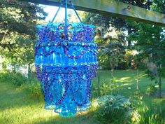 This talent is crazy! It would go great with our Midsummer Night Patio Ideas. Make a Plastic Stemware Patio Chandelier – yep, from The Dollar Store! More Dollar Store Crafts and Hacks on Frugal Coupon Living. Wine Glass Chandelier, Outdoor Chandelier, Diy Chandelier, Mobiles, Raised Garden Bed Plans, Dollar Tree Crafts, Diy Wedding Favors, Wedding Ideas, Dollar Stores