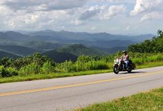 TEN BEST: Motorcycle Rides in the USA: (By Christopher P. Baker) There's something uniquely satisfying about touring by motorcycle. The enhanced sense of freedom. The heightened adventure and awareness as you sweep through twisties and curves. You could never get so close to nature's beauty from inside a car. Pictured: motorcyclist riding along the Blue Ridge Parkway in North Carolina.