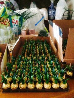 Behind the scenes look at our escort cards to fit our fun Hawaiian themed wedding: Ferrero Rocher turned into pineapples!