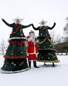Upshot Performance - These fun stilt walkers have some amazing costumes that will suit a variety of Christmas events. These include Christmas tree stilt walkers and even a Santa Claus stilt walker!