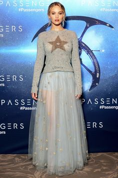 Jennifer Lawrence in a pale blue Dior dress and star sweater