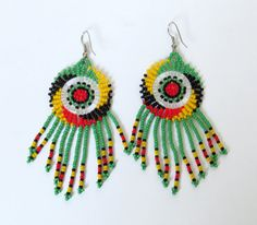 African Zulu beaded earrings - Dreamcatchers (small) - Rasta colours - Gift for her. **Every item is handcrafted, colours and sizes may slightly differ.*** Other accessories are sold separately. Chandelier Earrings, Beaded Earrings, Beaded Jewelry, Crochet Earrings, Jewellery, Zulu Women, Small Dream Catcher, Rasta Colors, Dream Catcher Earrings