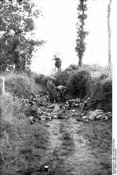 France, paratroopers in a ravine.