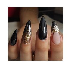 Stiletto with black glossy polish and gold glitter nail art | fall nail art ideas | decorado de unas