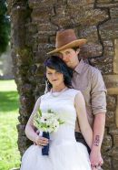 Jemma and Shane enjoy a peaceful moment at their western themed wedding at the Palace Stables in Armagh