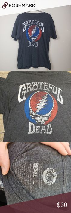 """Grateful Dead Distressed Band Graphic T-shirt Grateful Dead Band Tee. Has distressed Grateful Dead logo on the front. Size large. In excellent preloved condition. Materials include 50% cotton and 50% polyester. Measurements pit to pit 20.5"""" length 25.5"""". Smoke Free Home Pet Friendly Home Grateful Dead Shirts Tees - Short Sleeve"""