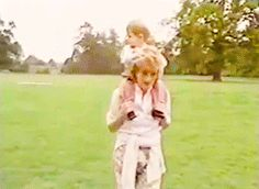 July 18, 1986: Princess Diana and Prince Harry. At Highgrove, Diana helped Prince William trot along on his pony while wearing a pair of floral pants, a pink button-down shirt and a cream-coloured sweater tied around her waist. With Prince Harry on her shoulders here.