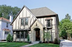 Architecture, Outdoor Yard American Iconic Tudor Design Style Beige Natural Stone Cladding Green Grass Glass Window Wooden Door White Wall F...