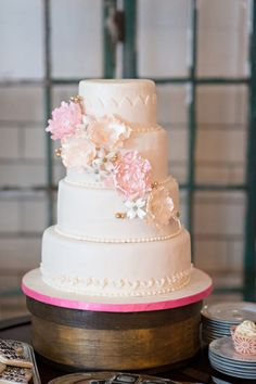 Gorgeous textured fondant cake with pink and gold details