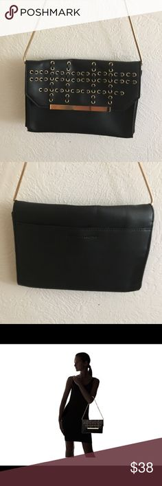French Connection Karen Clutch Used just once for a special occasion, Not your ordinary bag, this Karen w/ Whipstitch and Eyelets Clutch really steal the show. Made of polyurethane with woven and grommet detail. Flap with magnetic snap closure. Chained shoulder strap. Exterior back slip pocket. Signature logo embossed detail in back. Lining made of polyester and cotton. Interior zip pocket. Imported. Measurements: Bottom Width: 9 in Depth: 1 in Height: 6 3⁄4 in Strap Length: 24 in Strap…