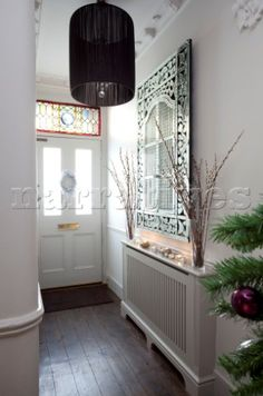 Bright and neat hallway with covered radiator