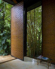 Casa Atelier / Carla Juaçaba and Mario Fraga Bamboo Architecture, Architecture Details, Interior Architecture, Interior And Exterior, Exterior Doors, Bamboo House Design, Pivot Doors, Wooden House, Entrance Doors