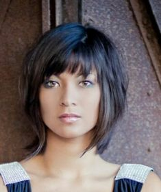 Razors layers, bangs, a touch of color to highlight shape of face