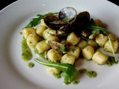 Potatoes gnocchi with clams and rocket pesto...