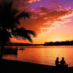 A fiery skyline and sunset silhouettes captured along the Noosa River.