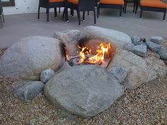 Natural Rock Fire pit...utilize boulders, large stones and sand or fire bricks to create an organic shaped pit. These types of designs work well in estate-type backyards or those that face lakes or other natural environments. They seem to connect your yard with the space beyond.
