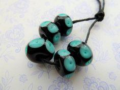 lampwork glass beads, black and teal spot set uk by LampworkbeadsbyJo on Etsy https://www.etsy.com/listing/594731839/lampwork-glass-beads-black-and-teal-spot