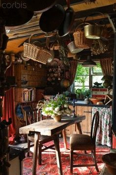 Cosy clutted country kitchen with pans and wicker baskets hung from the ceiling Cozy Cottage, Cottage Homes, Cottage Style, Irish Cottage Decor, Wooden Cottage, Cozy Kitchen, Rustic Kitchen, Country Kitchen, Primitive Kitchen