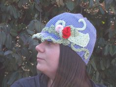 Latest addition to my Etsy shop KnitsbyShan. It is a Hand knit, Newsboy style hat in a silky soft Acrylic/Bamboo blend. This is a one-of-a-kind item, adorned with rosebuds in pink and red, vines and leaves in 2 different shades of green. Different Shades Of Green, Rose Buds, Hand Knitting, Vines, Bamboo, My Etsy Shop, Crochet Hats, Leaves, Cute