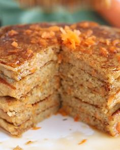 Its time to make the best gluten free pancakes youve ever tasted! Our carrot cake pancakes are made with ground oat flour carrot cake spices and freshly grated carrots. Whip up a batch for breakfast today or meal prep to enjoy throughout the week! Carrot Cake Pancakes, Carrot Spice Cake, Gluten Free Carrot Cake, Healthy Carrot Cakes, Gluten Free Pancakes, Oat Pancakes, Pancake Cake, Pancake Breakfast, Clean Breakfast
