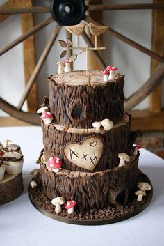 Woodland themed wedding cakes a brown three tier cake with initials in the . Woodland themed wedding cakes a brown three tier cake with initials in the heart . Floral Wedding Cakes, Themed Wedding Cakes, Wedding Cake Rustic, Cool Wedding Cakes, Beautiful Wedding Cakes, Wedding Cake Designs, Wedding Cake Toppers, Wood Themed Wedding, Heart Wedding Cakes