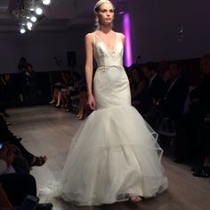 We love this bow-accented mermaid style. Gown by Jim Hjelm