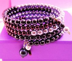 """The """"Elegant Amethyst"""", Lavender, Wine Color Blocked Crystal Pearls Wrap Bracelet is strung on stainless steel memory wire and it wraps around your wrist four times, with handmade dangling charms in various sized crystal pearls.(Bead size range 1-2mm-8mm) and the memory wire allows a nice comfortable fit, so these bracelets can be worn on arms of different sizes in adults. PLEASE NOTE: We photographed our product as accurate as possible however, due to different lighting, color settings…"""