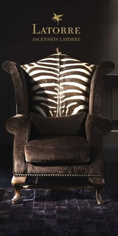 Zebra-print wing-backed chair. Unique Furniture, Luxury Furniture, Animal Print Furniture, Zebra Chair, Cowhide Chair, African Interior, Hanging Chair From Ceiling, British Colonial Style, Luxury Chairs