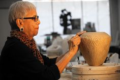 For almost six decades, Los Angeles ceramic artist Dora De Larios has been creating one-of-a-kind vessels, sculptures and monumental architectural installations embellished with fanciful flora, fauna and mythological characters. Now, at 81, despite a second battle with cancer and nine rounds of chemotherapy last year, De Larios is busier than ever — completing new commissions and collaborating on an elegantly understated line of artisanal tableware.