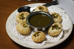 Pani Puri (little pastry shells filled with mung beans)