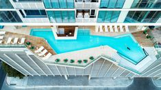 An angular outdoor swimming pool for residents occupies a deck on the ninth floor. The tower's various amenity rooms are finished in walnut and white oak.