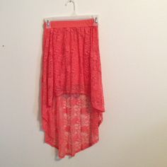 Lace High Low Skirt Only worn once!! Orange/coral lace high low lace skirt! The lace is a beautiful floral design! Waist band is stretchy material so could possibly fit a medium. There is a short skirt underneath the lace.  The material is 95% Cotton and 5% Spandex. Charlotte Russe Skirts High Low