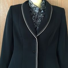 SALE Tahari suit jacket Stunning Tahari Arthur S. Levine suit jacket. Black with white trim. Size 4. Like new! In perfect condition. Classic staple piece to any business wardrobe. Tahari Jackets & Coats Blazers