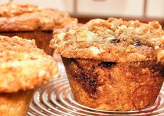 Sour Cream Coffee Cake Muffins Recipe on ComfortableFood.com  -  The texture in these sour cream muffins is amazing – they are just like coffee cake – firm and chewy, but not dry at all. They are perfectly sweet and the cinnamon sugar layer really does adds great flavor and sweetness.  The nutty crumble topping adds the perfectly crunch. For the complete recipe, simply click on the photo.  ENJOY!