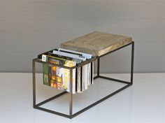 Magazine Side Table designed by Joshua Howe with space for storage and a place for drinks and coasters!