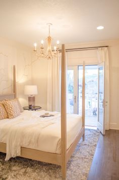 Lukas custom painted the wall with 24-carat gold accents. We love this guest bedroom! #DreamBuilders