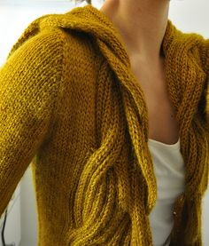 Super tough to find through this link, but it's on ravelry for FREE! under the name 'spinster' sweater.
