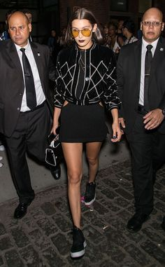 For after-dark celebrations in New York, Bella wore a cut-out dress with a bomber jacket and yellow-lensed sunglasses.