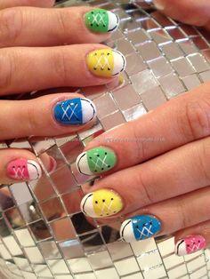 Multicoloured acrylic converse freehand nail art