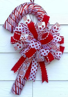 Your place to buy and sell all things handmade Peppermint door hanger christmas door hanger whimsical door Gold Christmas Decorations, Christmas Mesh Wreaths, Christmas Swags, Deco Mesh Wreaths, Outdoor Christmas, Christmas Crafts, Christmas Ornaments, Candy Cane Decorations, Holiday Decor