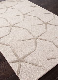 Wool and art silk is artfully hand-tufted into a pattern beige and taupe finger starfish,creating a wonderful Starfishing area rug to accent your beach house!