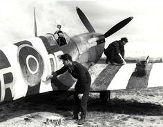 An RAF Supermarine Spitfire receives its D-Day invasion stripes; Tangmere Sussex England - 5 June 1944