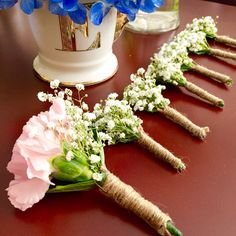 Baby's breath and carnations boutonniere. I do not want it to be just baby's breath.