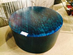 Color is coming on strong with blue and green as standouts. This artistic steel coffee table becomes the center of your living room with a unique flair.