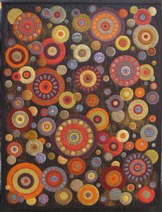 Circle quilt - not sure if this is actually a quilt, but I can see doing this in felt being much easier to accomplish