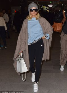 Incognito: The 18-year-old daughter of singer Lionel Richie was covered head-to-toe in dark shades and oversized poncho