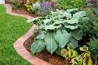 How to Edge a Garden Bed With Brick | Video | This Old House