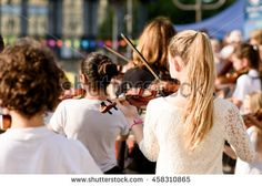 Selective focus at the violin play by kids.