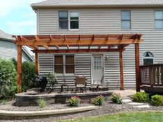 Pergola over #Patio. Covers only half of flat back facade.